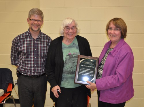 "Amy Steele Kempster is awarded a plaque on October 16th 2014 by the Champlain Park Community Association for 30 years as a community volunteer with achievements in negotiations with NCC, as our contact with the Federation of Community Associations, and in keeping us updated on current issues through her column ""Amy's Corner"" in our neighbourhood newsletter. Way to go, Amy! Presenters are Carol Arnason and Dennis Van Staalduinen.  Photo by John Arnason."