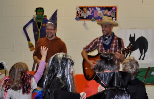 Peter Laughton (right) and Dennis Van Staalduinen entertaining children at the Halloween party.  Photo taken by John Arnason.