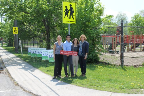 [Yasir Naqvi and supporters of the Safer School Zones Act]