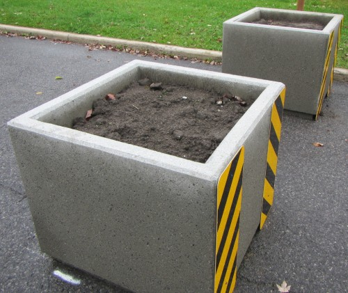 [Concrete Planters on Pontiac, with dirt installed]