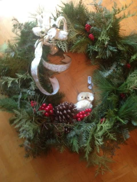 [Wreath with owl, berries, pine-cone]