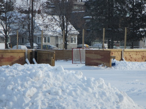 [Rink Gate open, showing hockey net waiting]