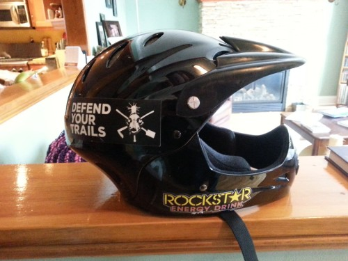 [Picture of a black plastic helmet]