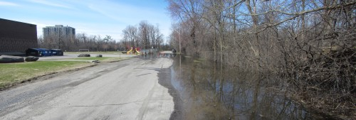 [Pontiac Street Flooded at Low Spot near St. Georges School]