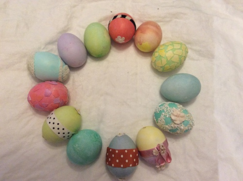 [A circle of painted and otherwise decorated eggs]