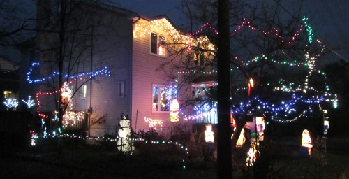 [House with strings of lights all over the place and hordes of glowing snowmen on the ground]