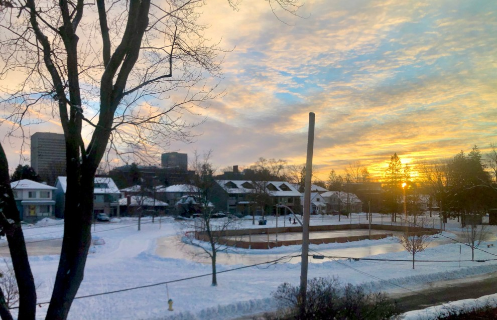 [Early morning sunrise over freshly flooded rink on January 18 2021]